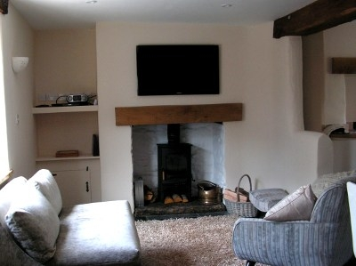 Cinnamon Teal Holiday Cottage lounge with Woodburner Instow, North Devon