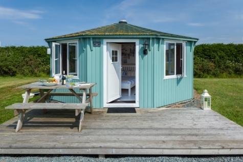 Luxury Glamping wood cabin at coastal cabins glamping